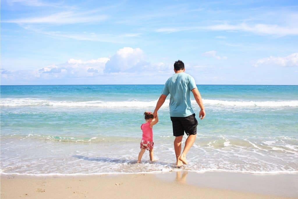Serendipity Anna Maria - Father and daughter walking on beach